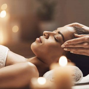 attractive-african-woman-enjoying-face-massage-in-spa-salon-scaled.jpg